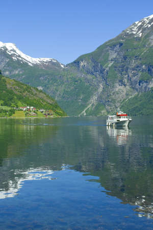 Boat in the ocean, Geiranger fjord, Norway view to the nature