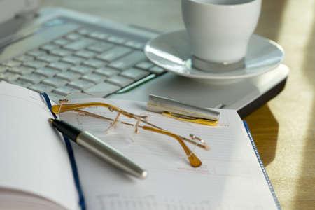 Break-time in the office, glasses, pen, diary