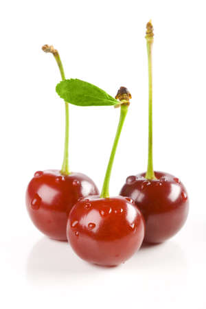 Ripe and fresh of three cherries with drops Stock Photo