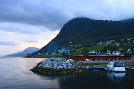Seaport in Norway with mountains and ocean Stock Photo