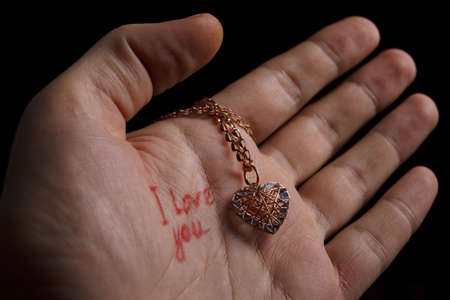 Declaration in love with necklace are on the hand Stock Photo