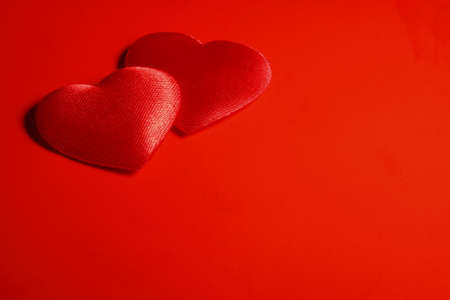 Two textile red hearts are at the top of the left corner. Stock Photo