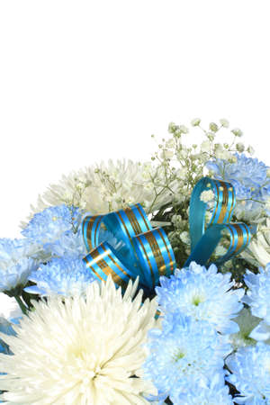Bouquet of white and blue chrysanthemums is decorate with ribbon.