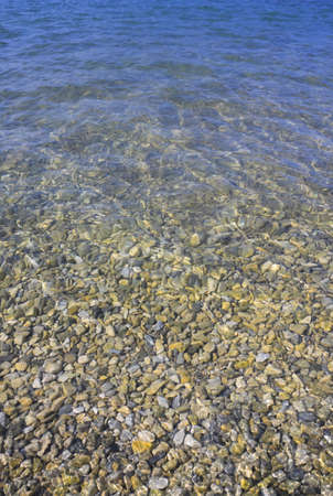 Sea floor with pebbles and water Stock Photo
