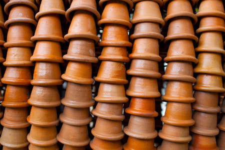 flower pots stacked in rows, background Stock Photo