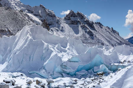 Close up of Khumbu glacier from Everest Base Camp, Himalayas, Nepal. Beautiful turquoise glacier ice blocks lit by a bright sun light on a clear day. Stunning Himalayan glacier landscape. Stock Photo
