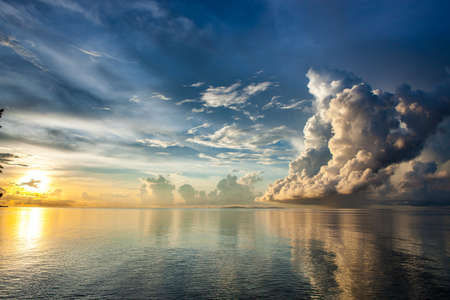 oceanic: Majestic oceanic sunrise above Sulu sea. Stunning view over Pacific ocean sunrise. Beautiful dramatic clouds ocean sunrise. Sunrise above ocean horizon.