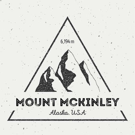 wanderlust: McKinley in Alaska, USA outdoor adventure logo. Triangular mountain vector insignia. Climbing, trekking, hiking, mountaineering and other extreme activities logo template.