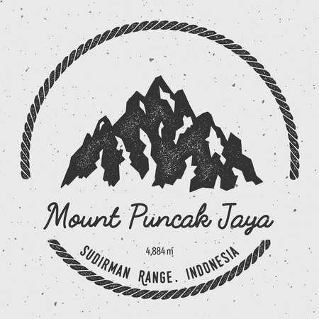 mountaineering: Puncak Jaya in Sudirman Range, Indonesia outdoor adventure logo. Round hiking vector insignia. Climbing, trekking, hiking, mountaineering and other extreme activities logo template.