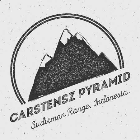 Carstensz Pyramid in Sudirman Range, Indonesia outdoor adventure logo. Round mountain vector insignia. Climbing, trekking, hiking, mountaineering and other extreme activities logo template.