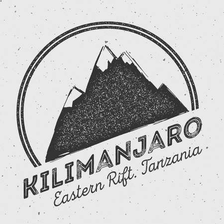 Kilimanjaro in Eastern Rift, Tanzania outdoor adventure logo. Round mountain vector insignia. Climbing, trekking, hiking, mountaineering and other extreme activities logo template.