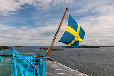 Sweden flag on ferry in Baltic sea.