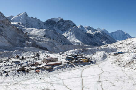 View over the Gorak Shep village from Kala Patthar near the Everest Base Camp, Himalayas, Nepal. Small remote high-altitude settlement among high snowy mountains landscape.