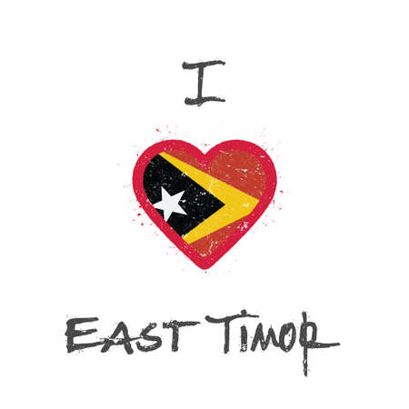 I love Timor-Leste t-shirt design. East Timorese flag in the shape of heart on white background. Grunge vector illustration.
