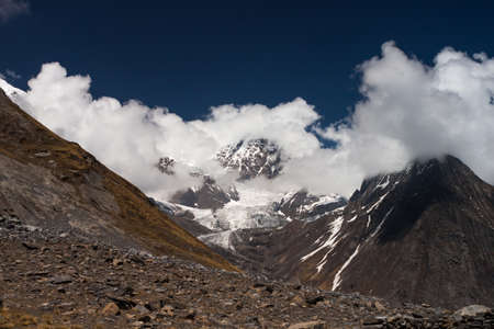 Mt. Tilicho peak covered by white clouds in Himalayan mountains, Nepal. Version 2. Stock Photo