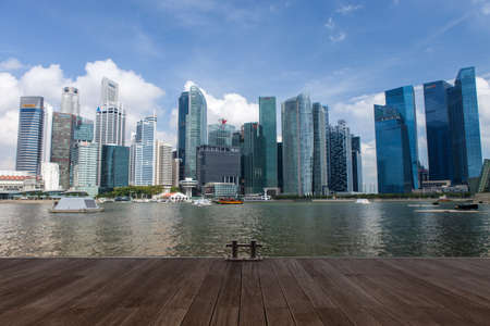 SINGAPORE - Mar 26, 2015: Singapore downtown across marina bay from jetty in daylight. Version 2.