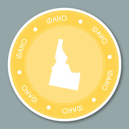 Idaho label flat sticker design. Patriotic US state map round lable. Round badge vector illustration.