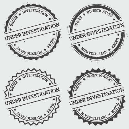 Under Investigation insignia stamp isolated on white background. Grunge round hipster seal with text, ink texture and splatter and blots, vector illustration.  イラスト・ベクター素材