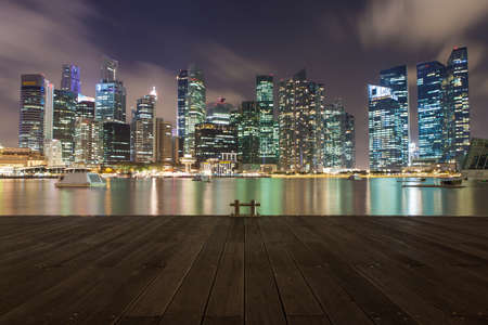 SINGAPORE - Mar 26, 2015: Singapore downtown across marina bay from jetty at night. Version 2.
