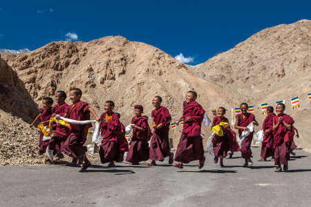 CHEMREY, LADAKHINDIA - September 17, 2013: Group of happy buddhist kids running to the temple. Version 2.