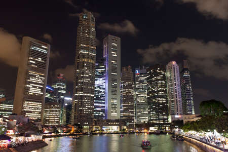 SINGAPORE - Mar 26, 2015: Singapore river and downtown at night. Version 2.