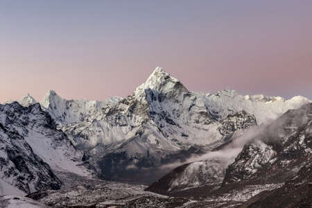 Sunrise view of the mountain Ama Dablam summit on the Everest Base Camp trek in Himalayas, Nepal. Captivating photo.