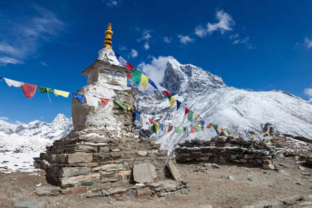 Buddhist prayer flags on a buddhist chorten on Everest Base Camp route in Himalayas, Nepal.