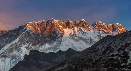 Beautiful sunset over Himalayan mountains on a clear day. Bold photo.