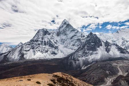 Beautiful view of Ama Dablam mountain summit on the famous Everest Base Camp trek in Himalayas, Nepal. Elegant photo.