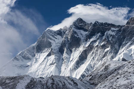 Dramatic view over Himalaya mountains on a cloudy day. Brilliant photo.