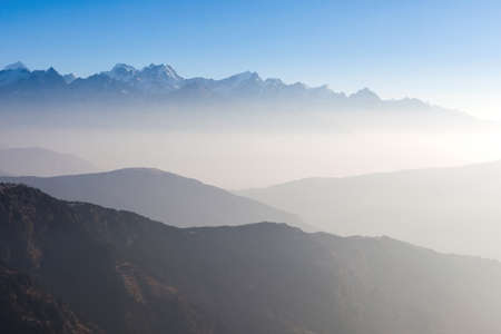 Misty landscape in himalayas. Foggy mountain shapes. Beautiful view on everest base camp track. 写真素材