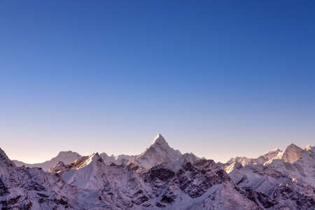 Himalayan mountain range with majestic morning light. Ama Damlam peak on everest base camp trek. Blue sky and beautiful mountains background.