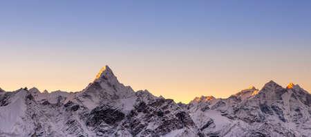 Pinkish sunrise above himalayan peaks. Cover sized photo. Beautiful high mountains landscape.