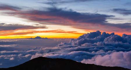 Beautiful cloudscape with mt. Rinjani at horizon. View from mt. Agung at sunrise. Bali, Indonesia. Standard-Bild