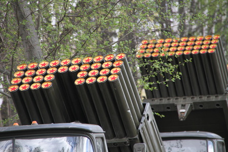 militarily: Red stars on the barrels of guns on the background of trees Stock Photo