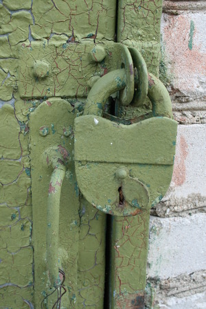 Old iron lock on the door  Castle green painted photo