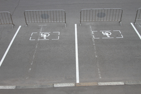 Signs of Parking for disabled people on the pavement, Parking blocked. Russia photo