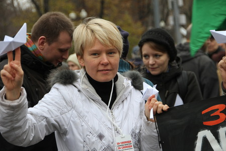 ecologists: Moscow, Russia - 27 October 2013. The March of the Russian opposition in support of political prisoners. Russian environmentalist Yevgeniya Chirikova support crew arrested ship Greenpeace Arctic Sunrise Editorial