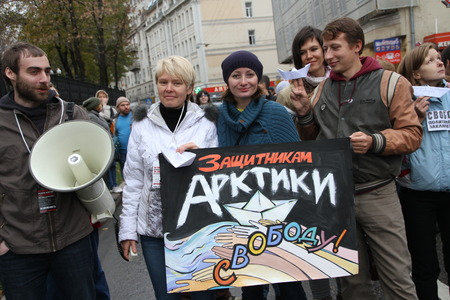 ecologists: Moscow, Russia - 27 October 2013. The March of the Russian opposition in support of political prisoners. Boris Beilinson, Evgeniya Chirikova and unknown protesters in support of the Arctic Sunrise Editorial