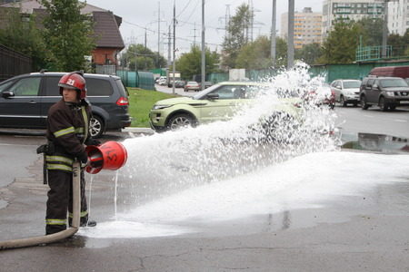 Moscow, Russia - September 7, 2013 Open day at the firehouse MOE. Unknown Russian firefighter demonstrates the operation of the extinguishing system