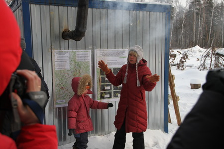 Khimki, Russia - February 1, 2012. Policies Evgeniya Chirikova and her daughter in the camp of the defenders of the Khimki forest tells the representatives of international organizations about their struggle. The camp of environmentalists is on the site o