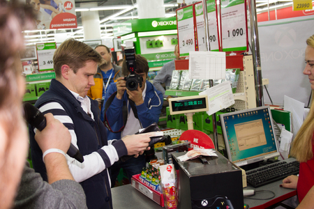 xbox: Moscow, Russia - September 25, 2014. First buyer XBOX ONE in Russia, the store MVIDEO. At 21.00 in Russia started console selling new consoleconsole