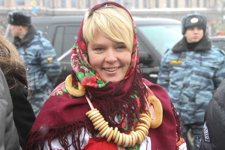 environmentalist: Moscow, Russia - February 26, 2012. environmentalist Evgeniya Chirikova shares White ring in the protection of fair elections. The action occurred on the Russian holiday of Maslenitsa Evgenia Chirikova in traditional folk costume
