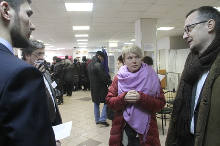observers: Moscow, Russia - March 4, 2012. Elections in Russia. Policies Evgeniya Chirikova communicates with observers at the polling station