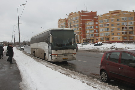 Moscow, Russia - March 4, 2012. Electoral fraud in Russia. A bus with people from the authorities, who vote at multiple polling stations simultaneously