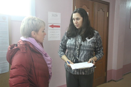 Khimki, Moscow region, Russia - March 4, 2012. Elections in Russia. Policies Evgeniya Chirikova and candidate Natalia Alymova at a polling station in Khimki