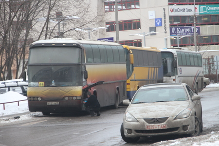 polling: Moscow, Russia - March 4, 2012. Electoral fraud in Russia. A bus with people from the authorities, who vote at multiple polling stations simultaneously