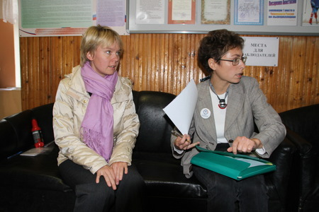 polling: Khimki, Moscow region, Russia - October 14, 2012. Candidate for mayor of Khimki opposition leader Yevgenia Chirikova and the observer for the elections at a polling station. On election day in the suburban town of Khimki broke sharp competition between th Editorial
