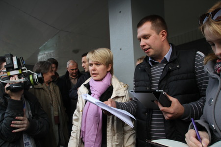 polling: Khimki, Moscow region, Russia - October 14, 2012. Candidate for mayor of Khimki opposition leader Yevgenia Chirikova and her head staff Nikolai Laskin communicate with the press outside the polling station. On election day in the suburban town of Khimki b