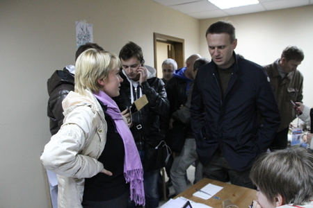 communicates: Khimki, Moscow region, Russia - October 14, 2012. Candidate for mayor of Khimki opposition Evgeniya Chirikova communicates with the politician Alexei Navalny, who came in her campaign headquarters. On election day in the suburban town of Khimki broke shar